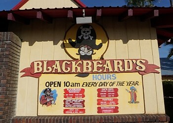 Sign showing hours open on the front of Blackbeard's entertainment center.